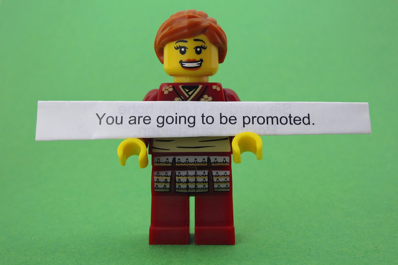 Picture of a lego man with sign that says you are going to be promoted