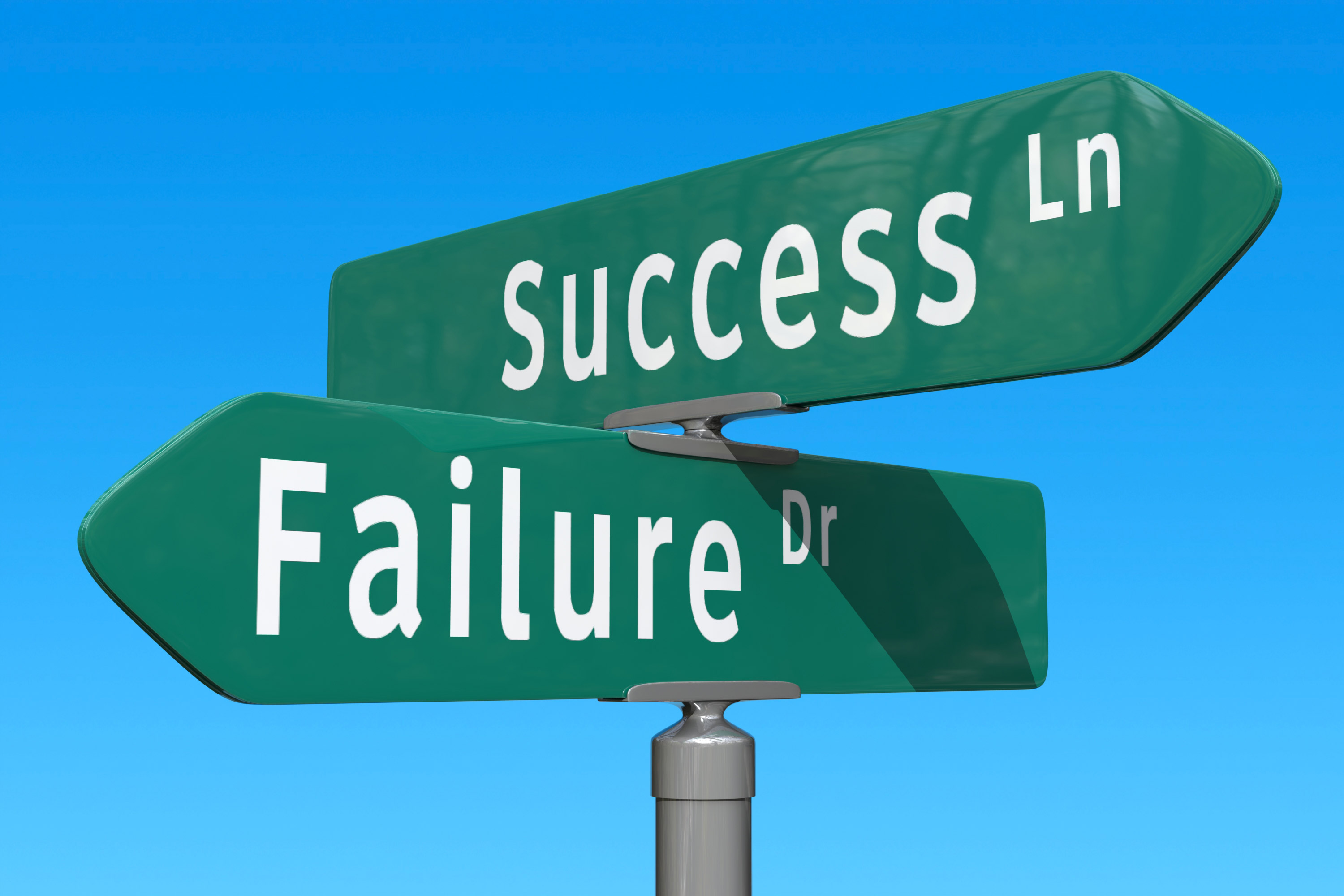 Picture of road signs pointing in opposite directions one saying Success and the other saying Failure
