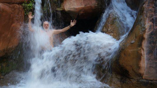 Man taking lake shower